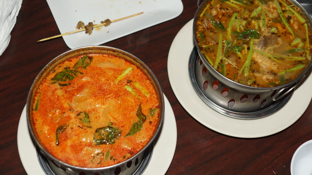 """On the left, Khmer curry. On the right, the crowd favorite, Ma Joo Krueng or """"sour """" """"lemongrass paste """" curry soup with beef."""